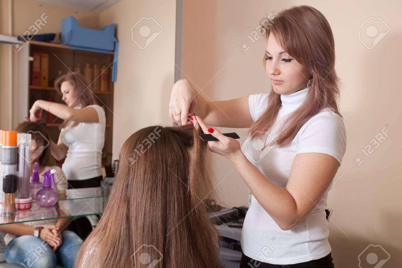 Hair Stylist Works On Woman Hair In Salon Stock Photo Picture And