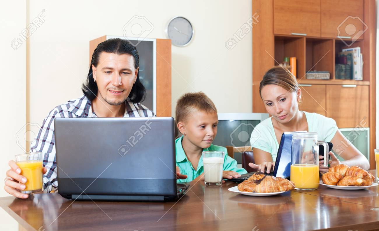 parents and teen bay having breakfast in a house interior Stock Photo - 23370273