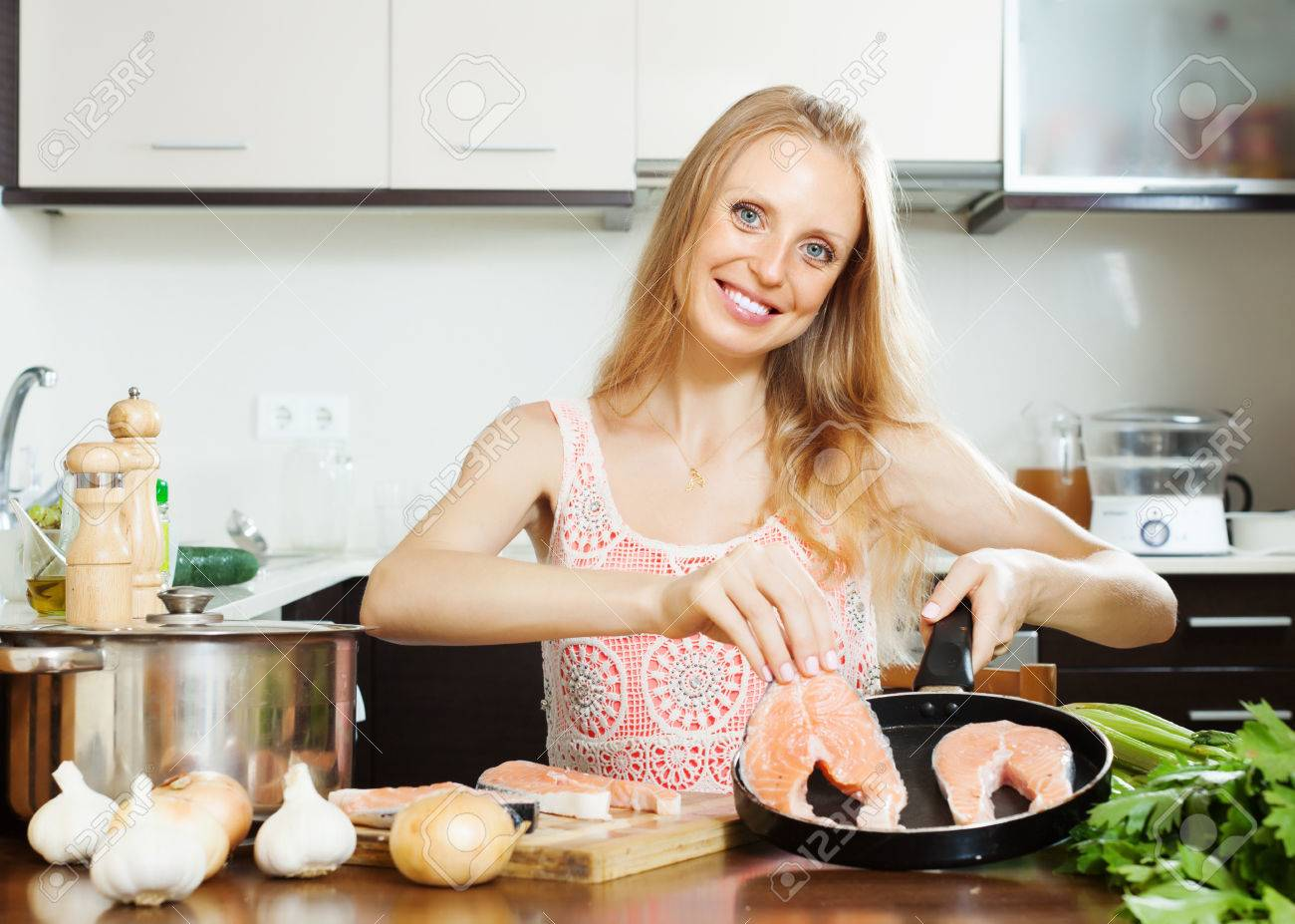 Home Kitchen Cooking Housewife Cooking Raw Salmon At Home Kitchen Stock Photo Picture