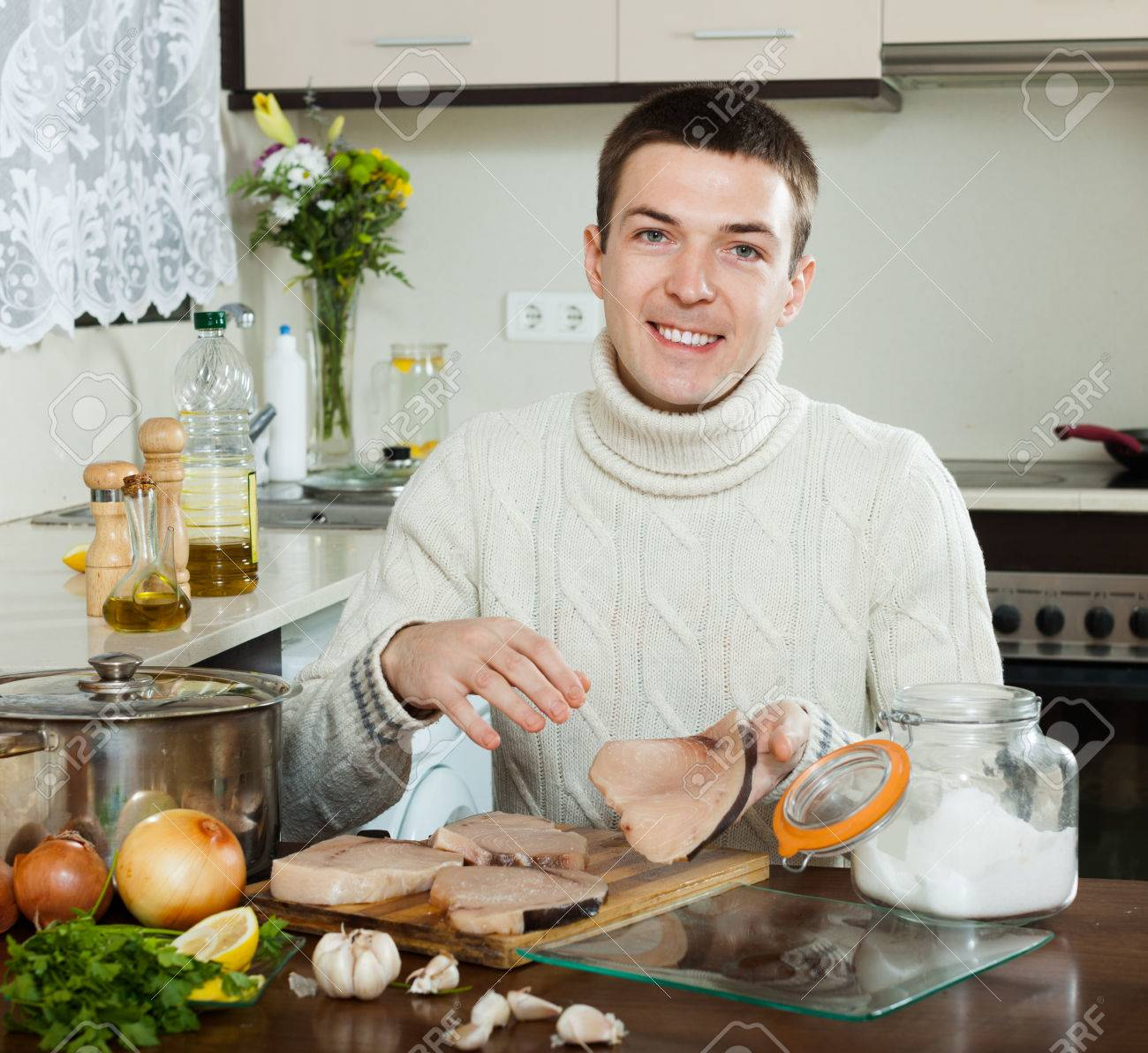 Home Kitchen Cooking Happy Handsome Man Cooking Steak Of Porbeagle In Home Kitchen