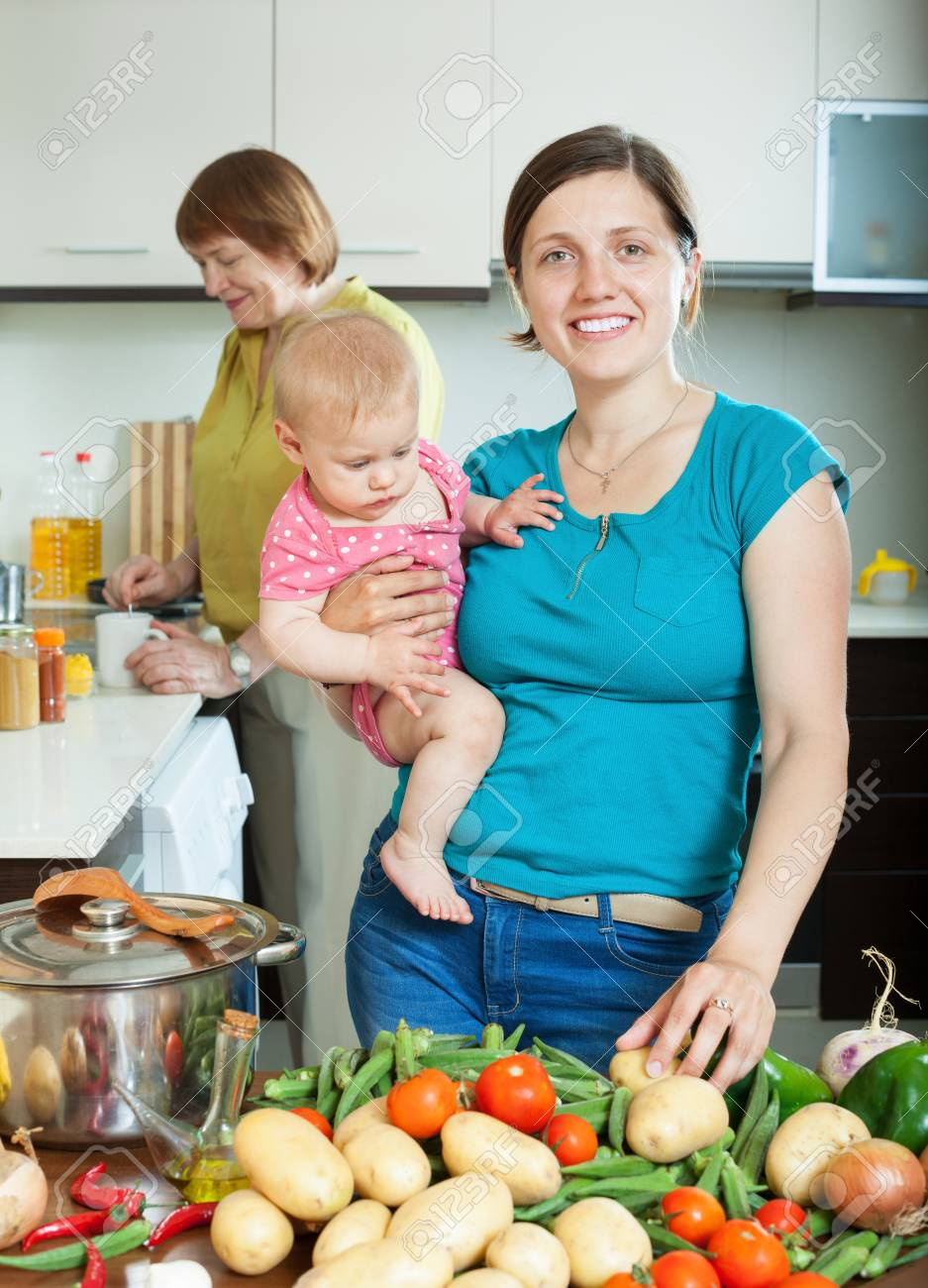 Happy Women Of Three Generations In Domestic Kitchen Stock Photo ...