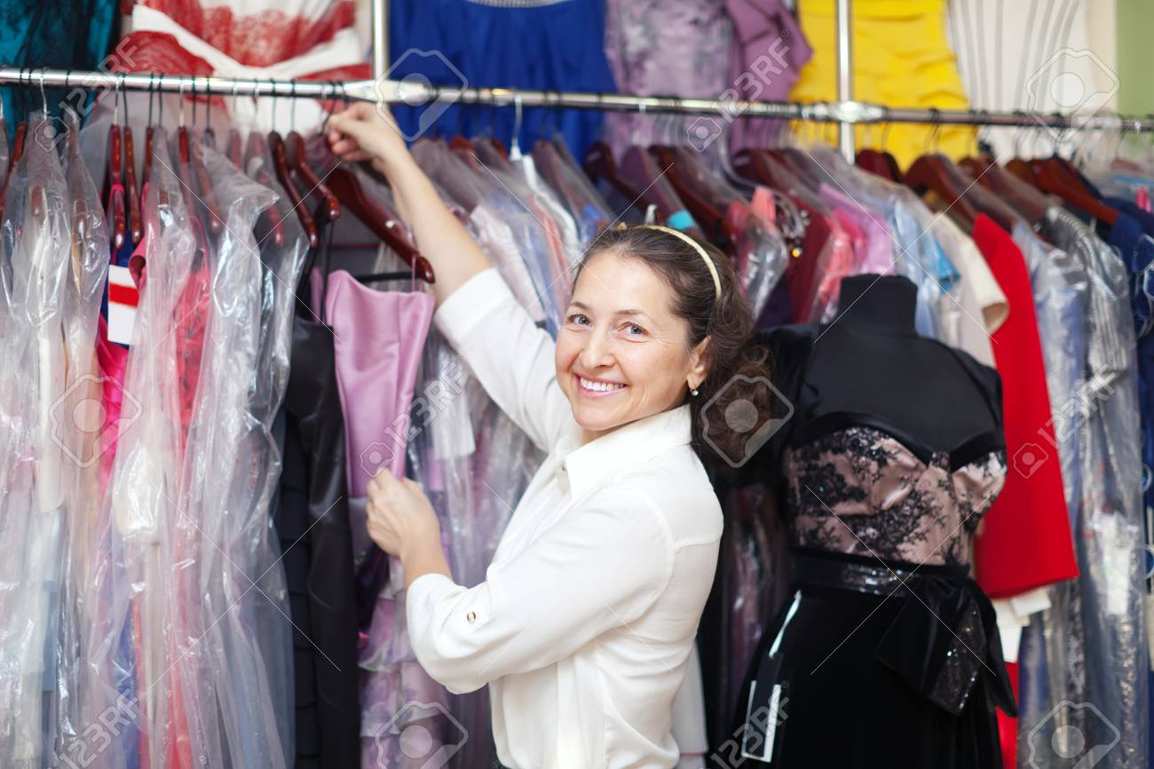 Happy Mature Woman Chooses Evening Gown At Clothing Store Stock ...