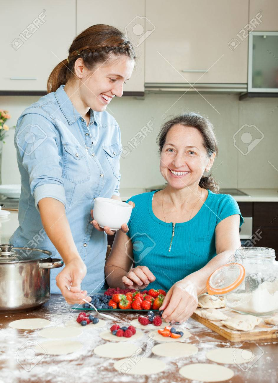 Two Women Making Sweet Vareniki With Berries Together At Home ...