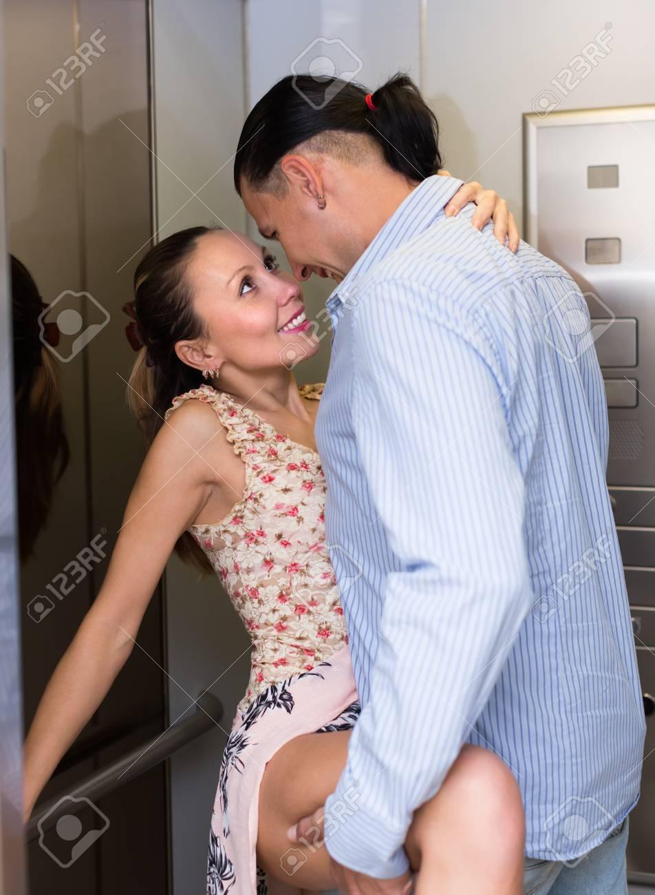 Impatient adult couple having at elevator - 34628456