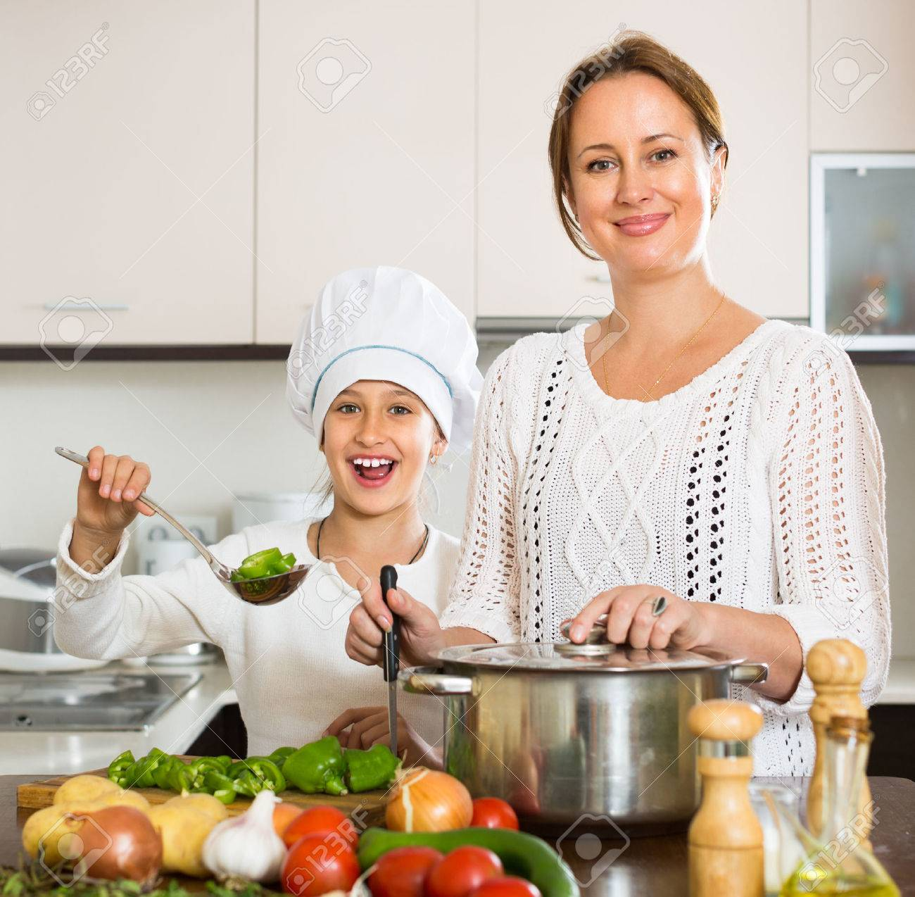 Cheerful Daughter And Happy Mom With Vegetables And Casserole ...