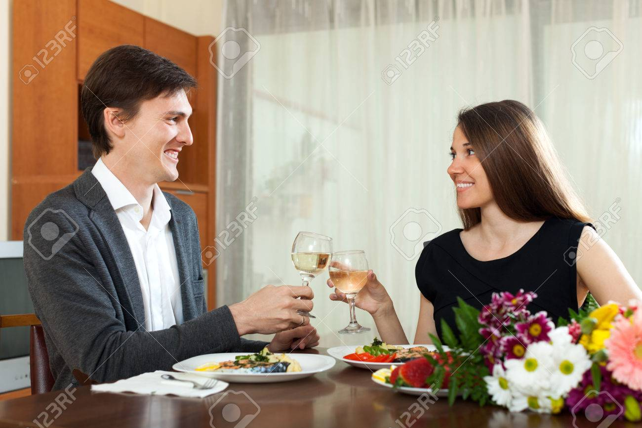 Happy Man And Woman Having Romantic Dinner In Home Stock Photo ...