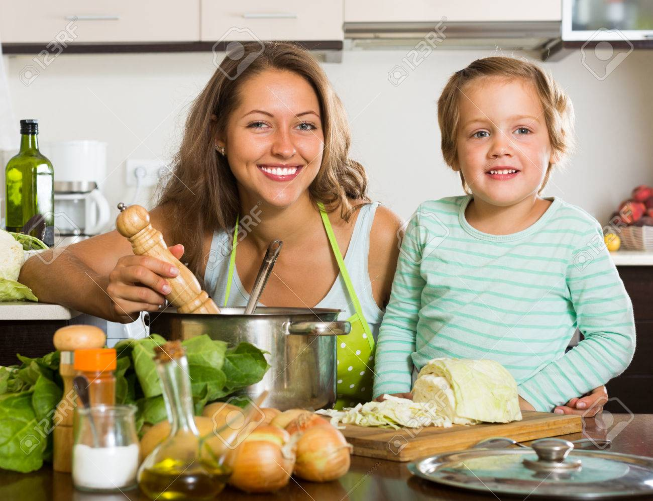 Family cooking kitchen - Happy Family Cooking Soup At Home Kitchen Stock Photo 41898170