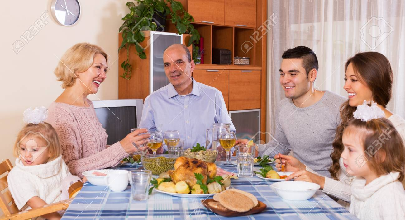 Multigenerational positive family having lunch together at room - 41188651
