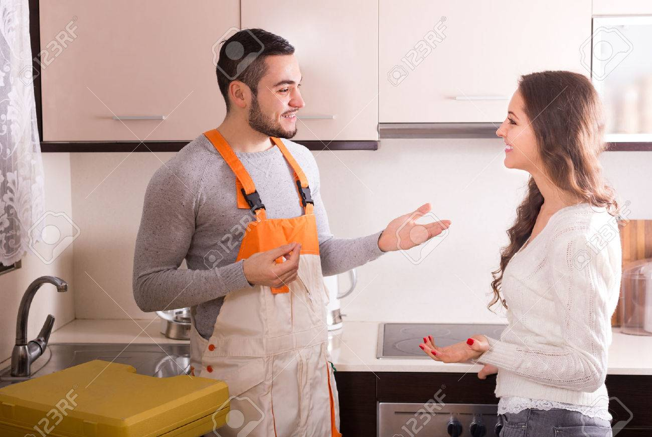 Professional workman visiting customer for repairing water lines Stock Photo - 44429721