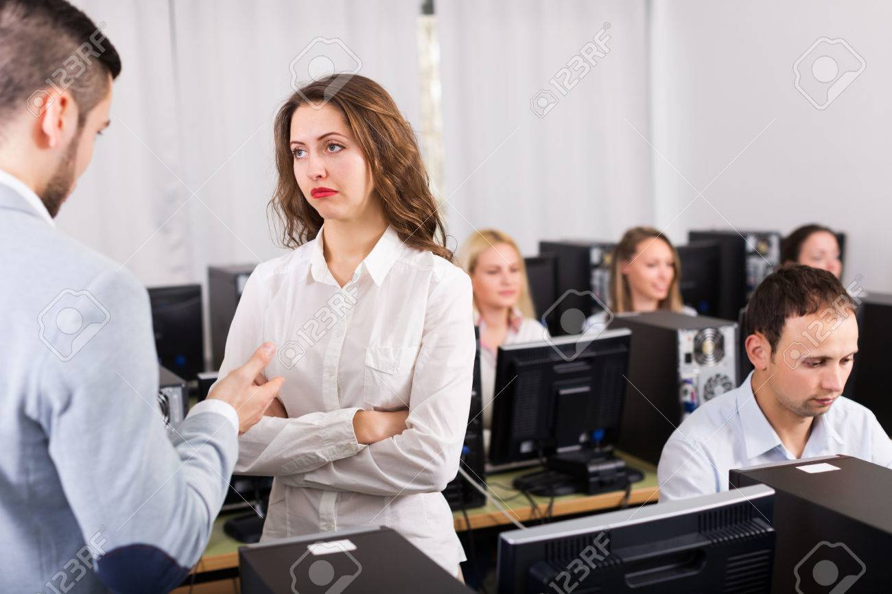 Strict boss and crying clerk at open space working area - 44787980