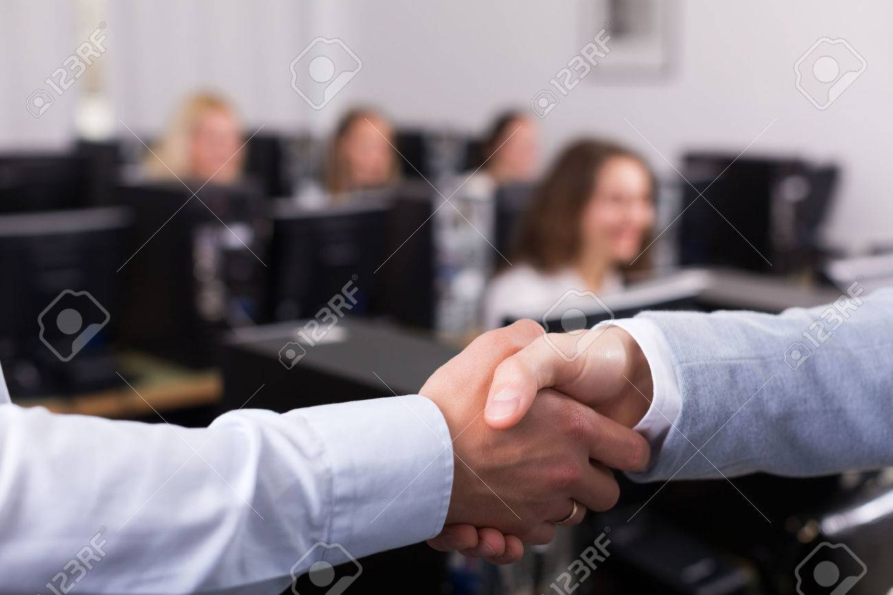 Satisfied adult customer service manager shaking hand of employee Stock Photo - 45502375