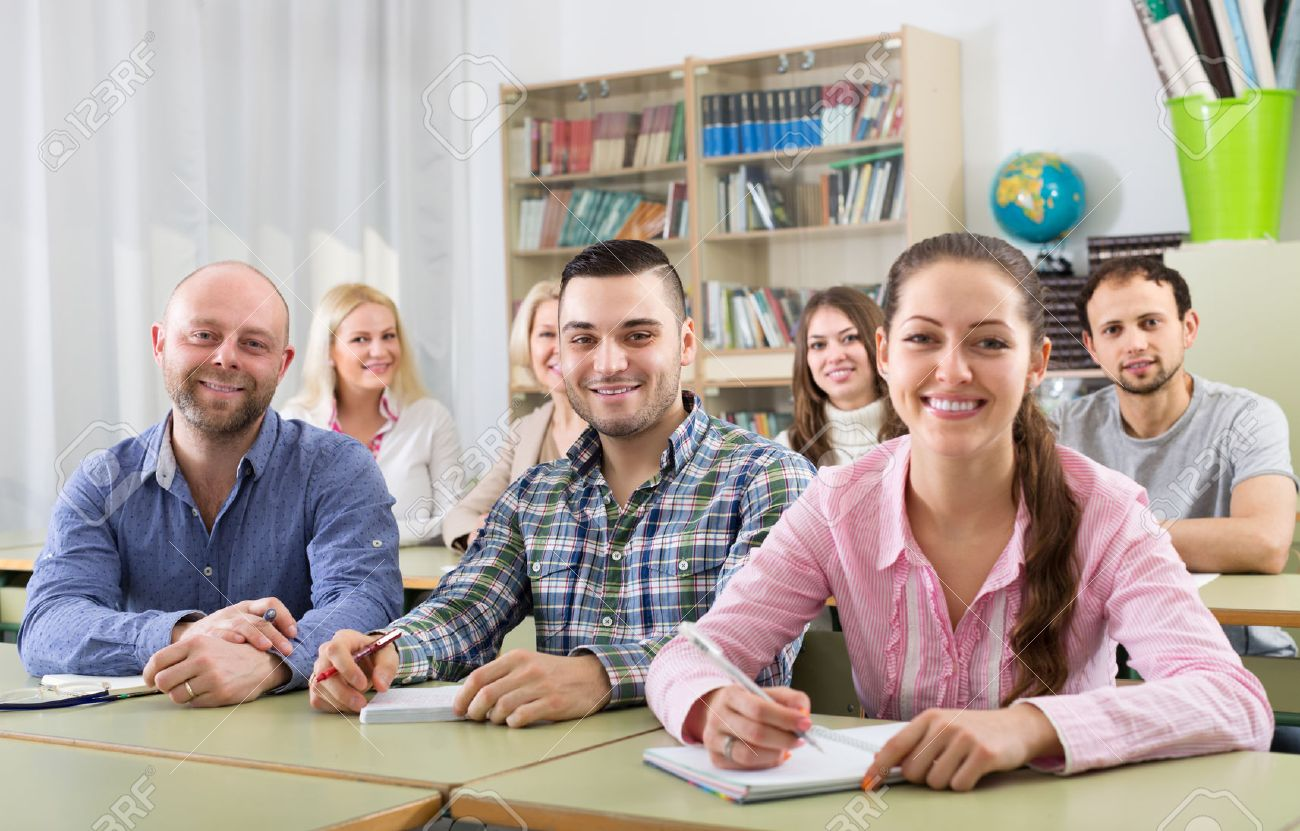 Smiling adult students of different age at extension courses in classroom Stock Photo - 45618065