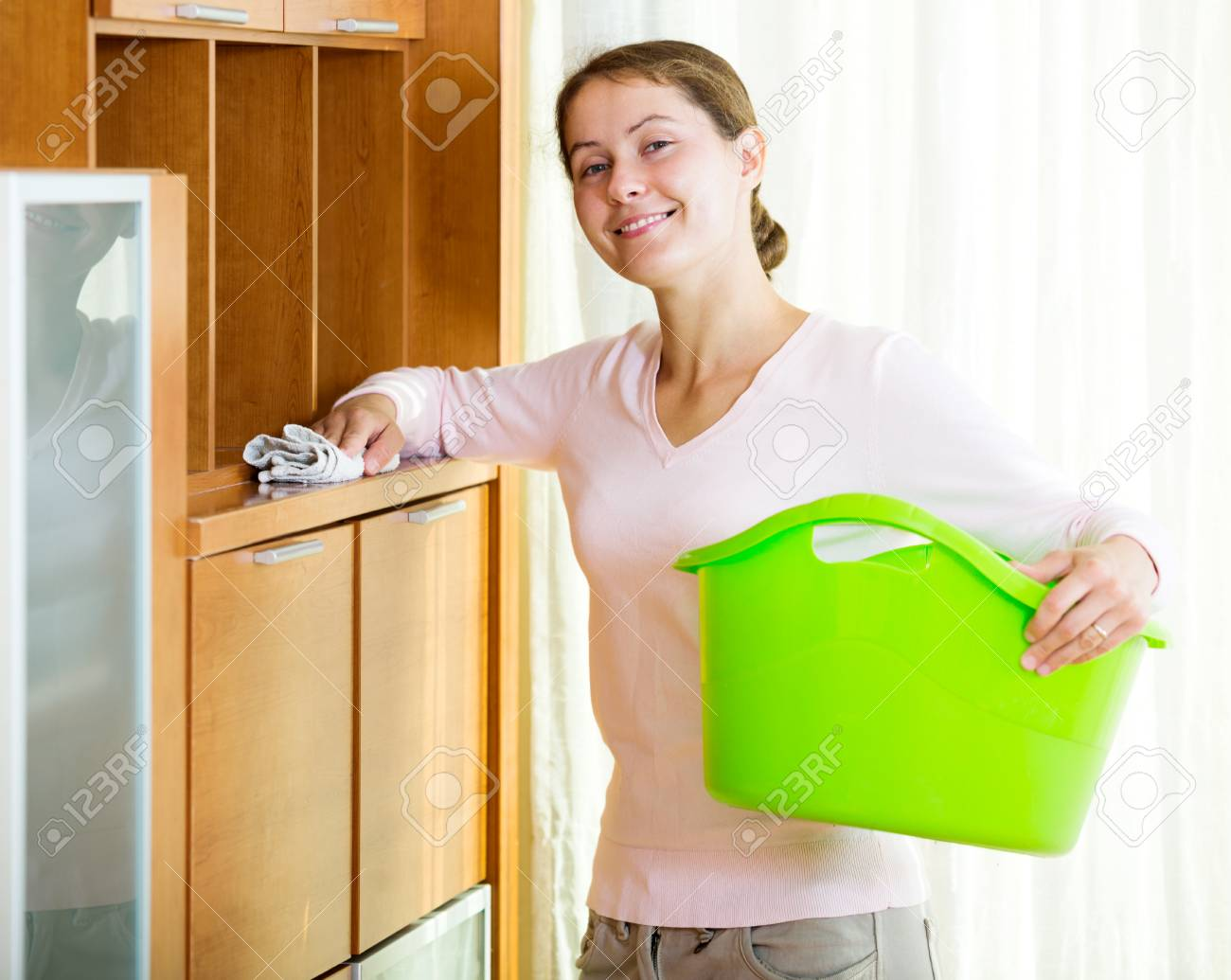 dusting furniture. Portrait Adult Woman Dusting Furniture At Home And Smiling Stock Photo - 47345232 H