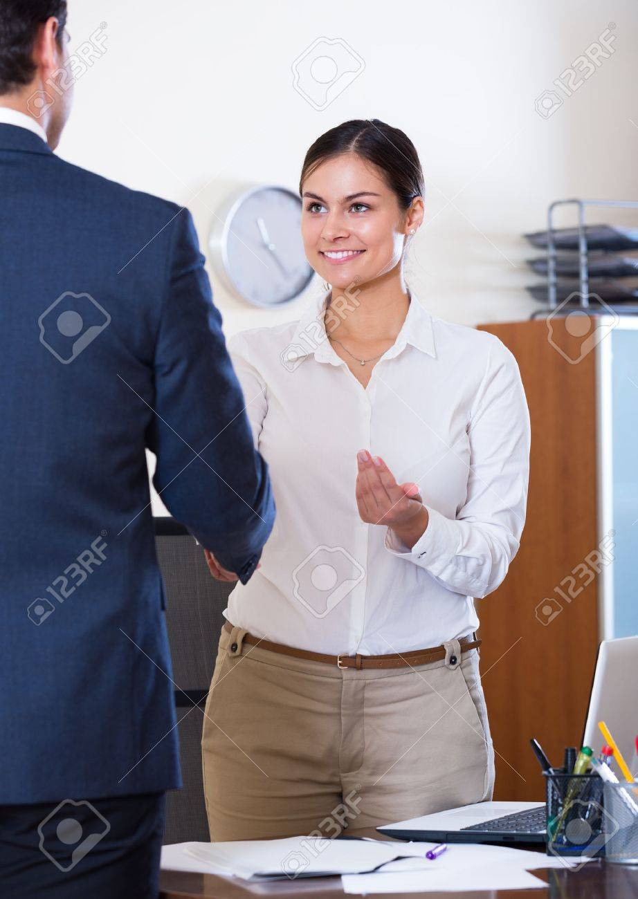 smiling chief manager hiring assistant after job interview at smiling chief manager hiring assistant after job interview at office stock photo 47625278