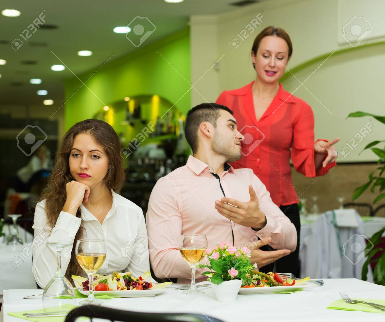 Unpleased man talking with polite manager in restaurant Stock Photo - 47749363