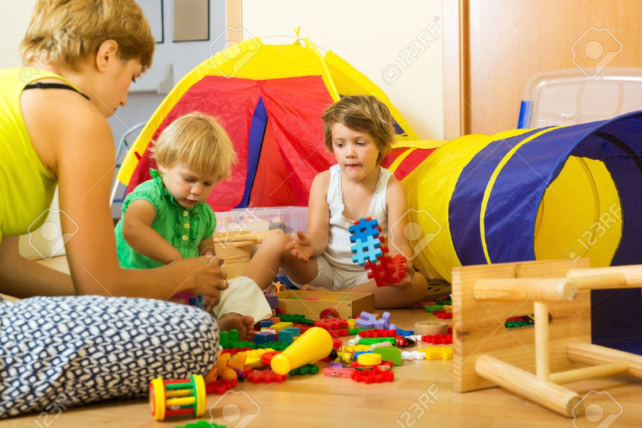 Young mother and children playing with  toys in home Stock Photo - 47916529