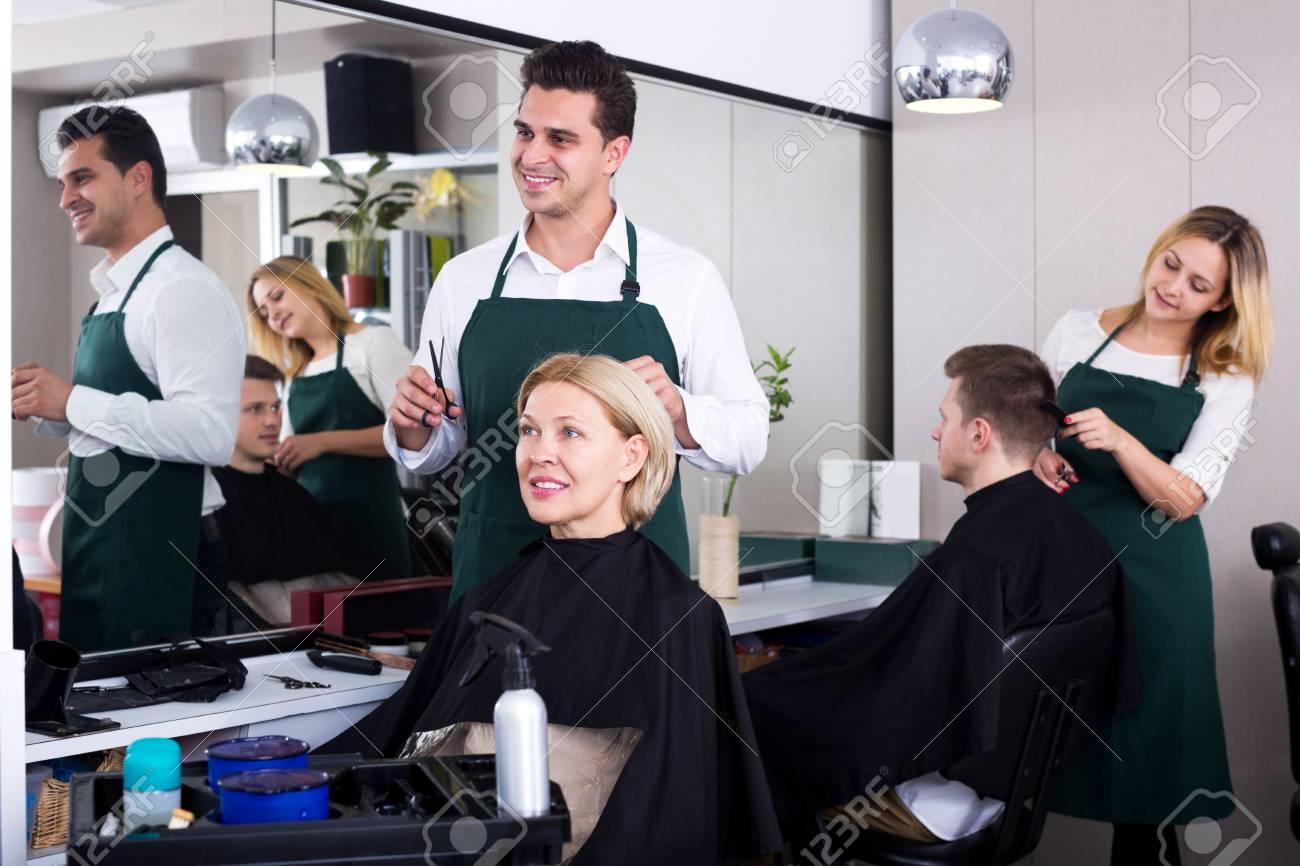 Fabulous Positive Male Stylist Cutting Hair Of Elderly Blonde In Salon Download Free Architecture Designs Rallybritishbridgeorg