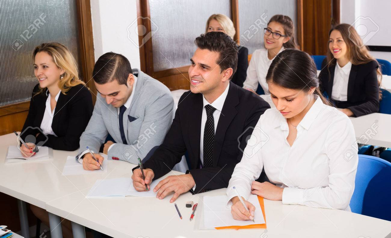 Attentive adult business students at the desks in classroom. Selective focus Stock Photo - 48789367