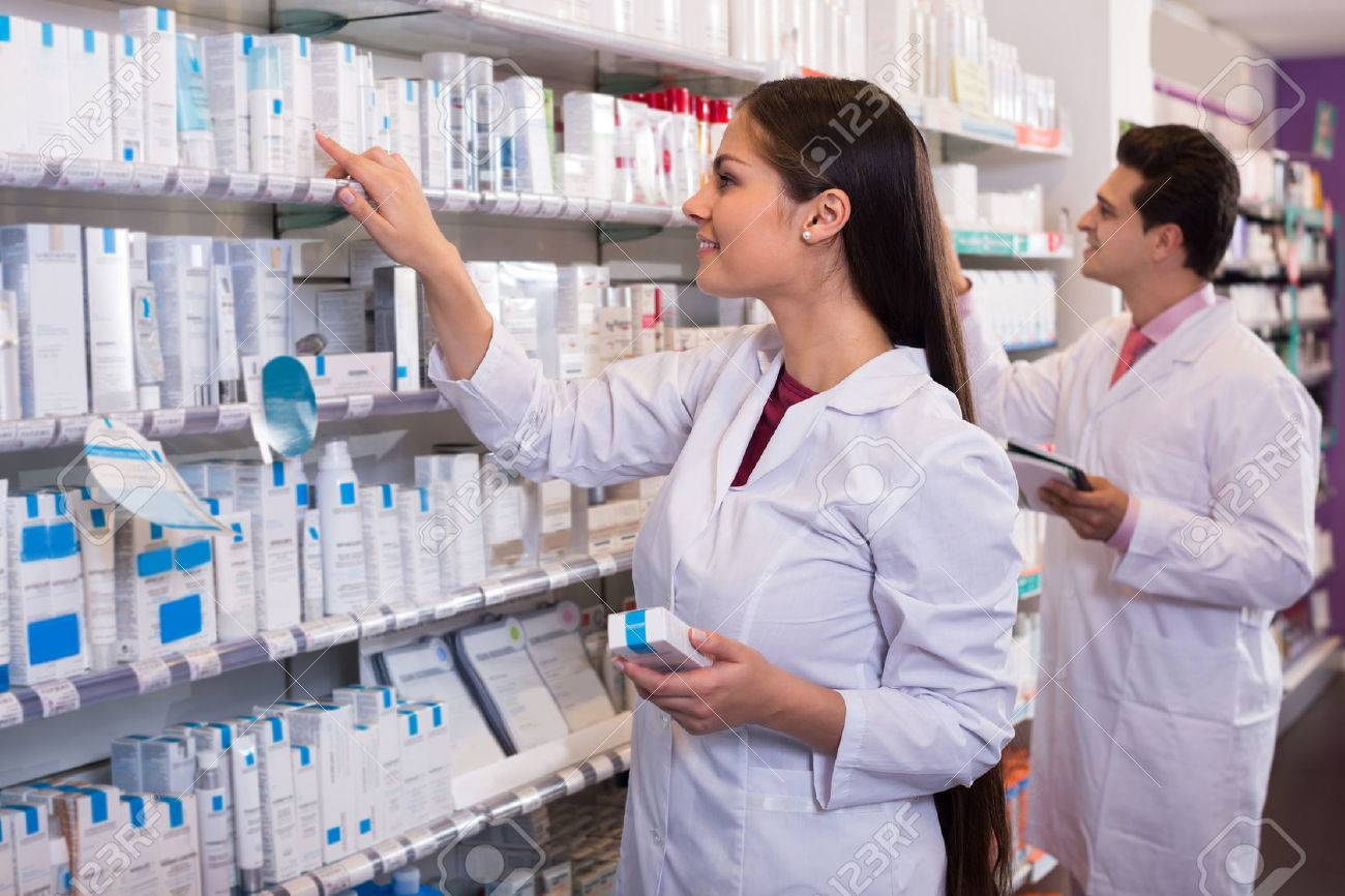 Smiling pharmacist and indian pharmacy technician posing in drugstore - 51086601