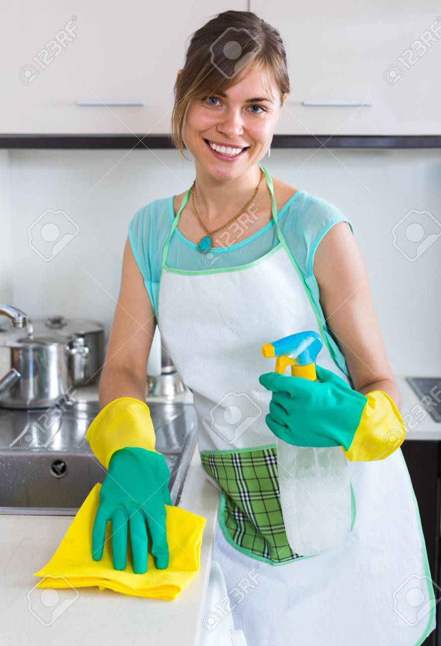 Young Positive Maid Doing Professional Clean-up In Home Kitchen ...