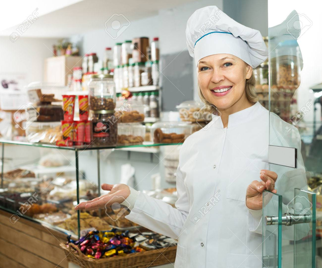 Happy mature chef with hat meeting customers at door in pastry shop Stock Photo - 53595898  sc 1 st  123RF.com & Happy Mature Chef With Hat Meeting Customers At Door In Pastry ...