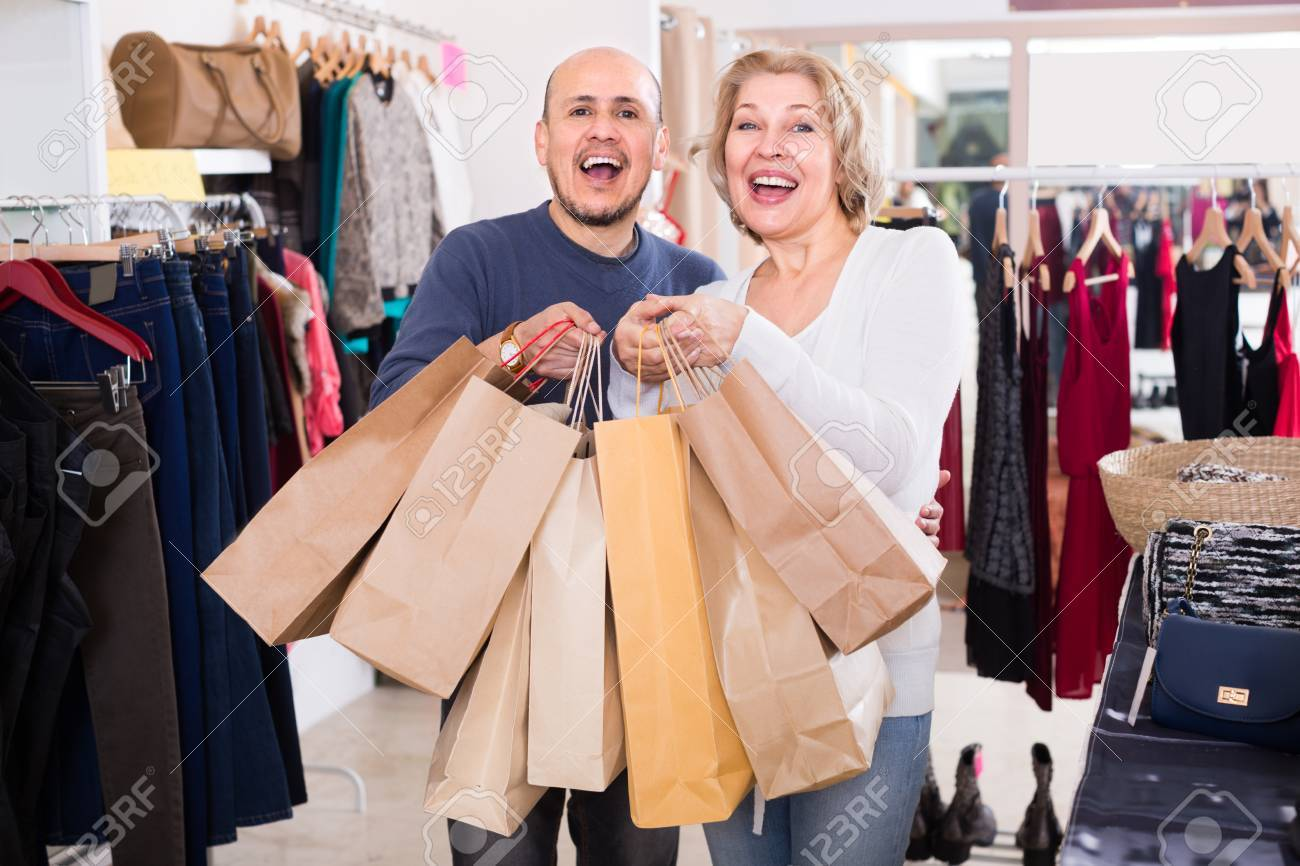 Image result for husband carrying wife's shopping bags