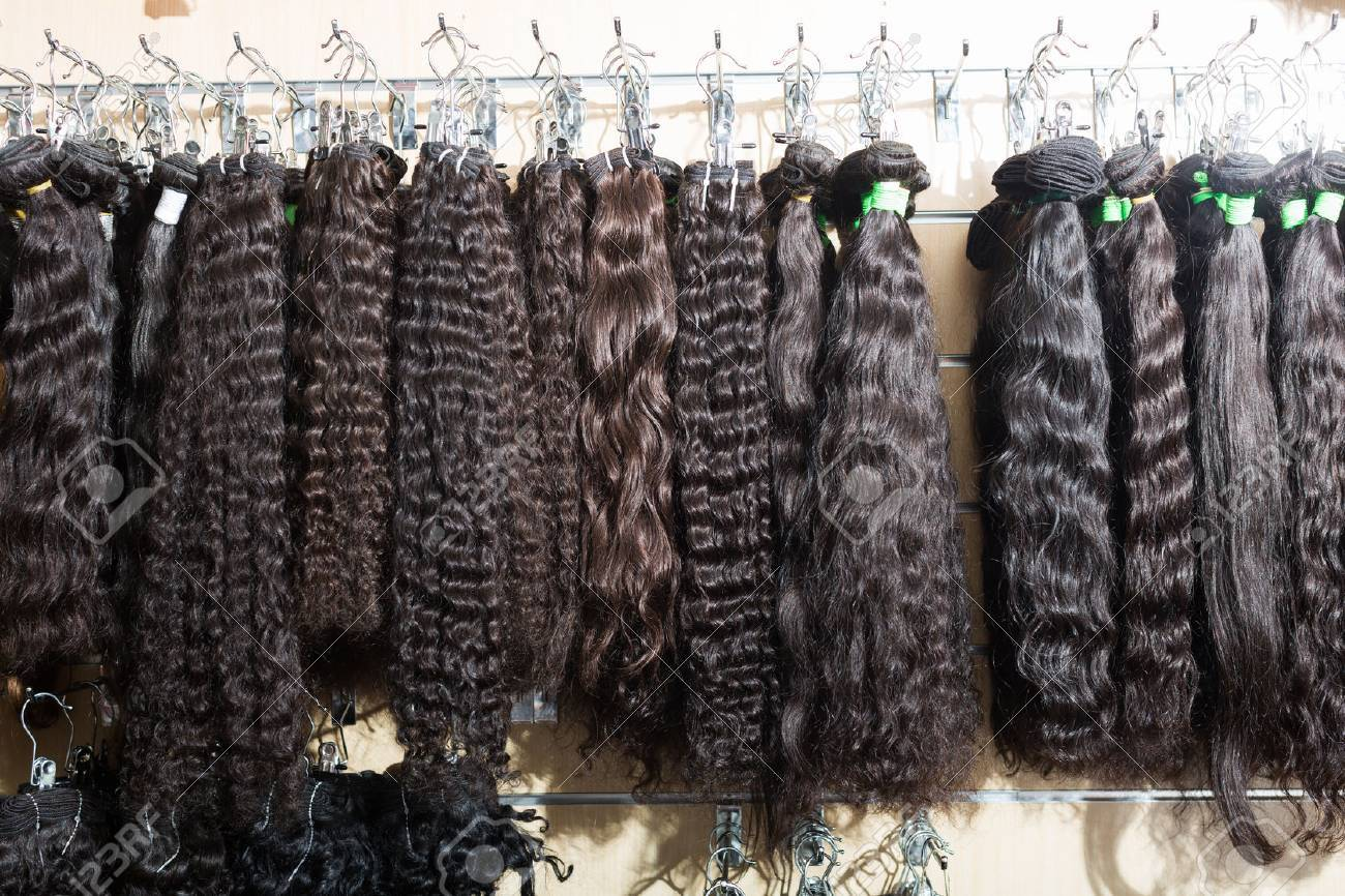 Assortment of beauty human hair extensions in salon - 55447679