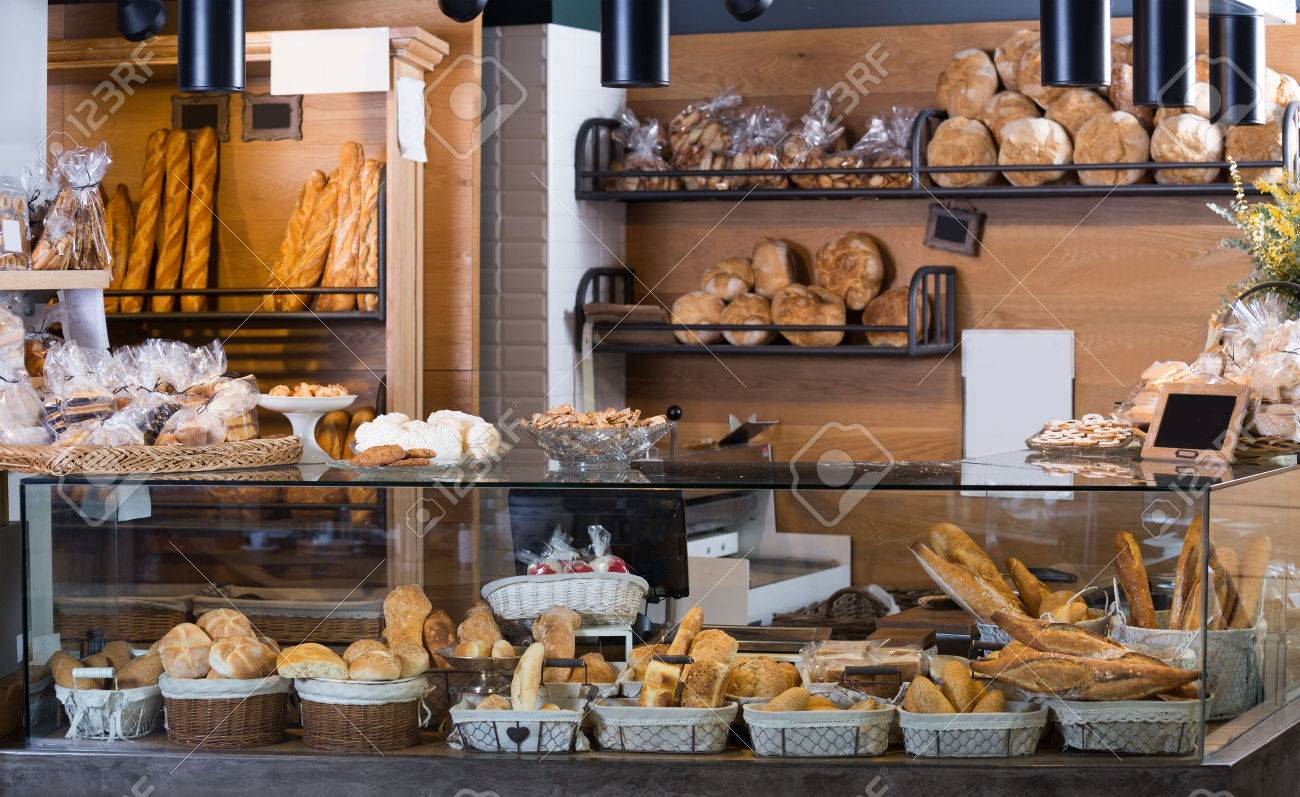 Buns, baguettes and other fresh bread at bakery display Stock Photo - 57312974