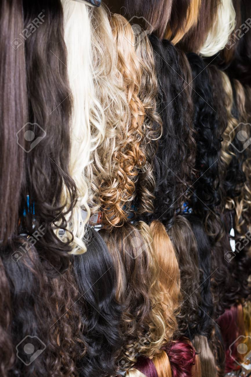Assortment Of Different Color Human Hair Extensions In Salon Stock
