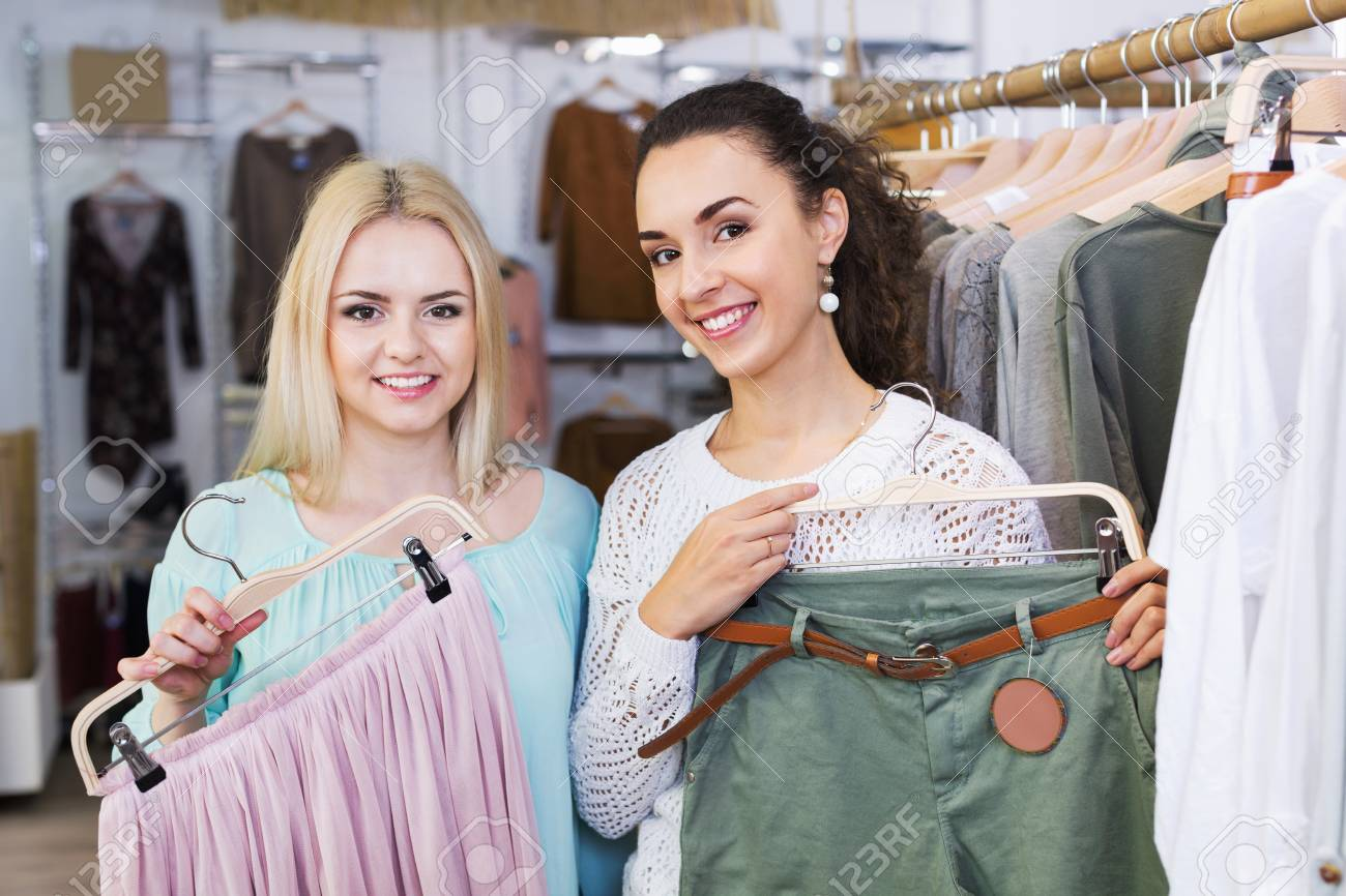 e6b71cce9c4b1 Positive young women shopping at the clothing store Stock Photo - 60023048