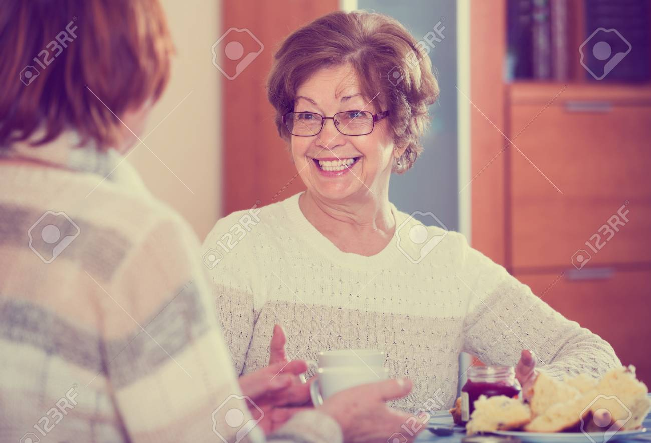 Happy mature housewives