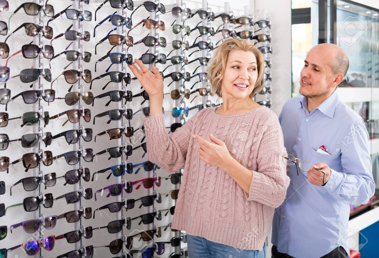 Senior Russian Couple Trying Spectacles Frames And Smiling Near ...