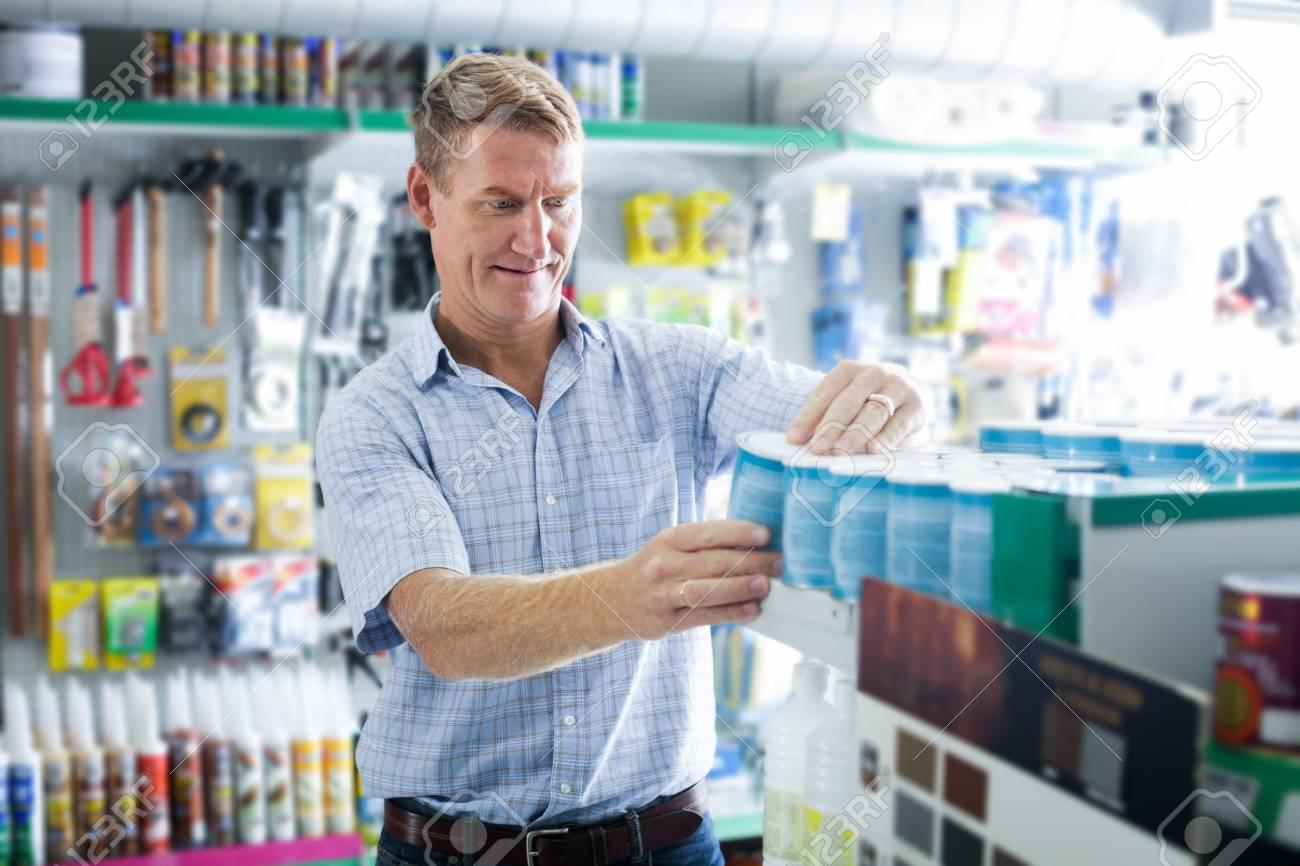 Concentrated Man Customer Choosing Paint Bucket In Housewares Stock Photo Picture And Royalty Free Image Image 67511044