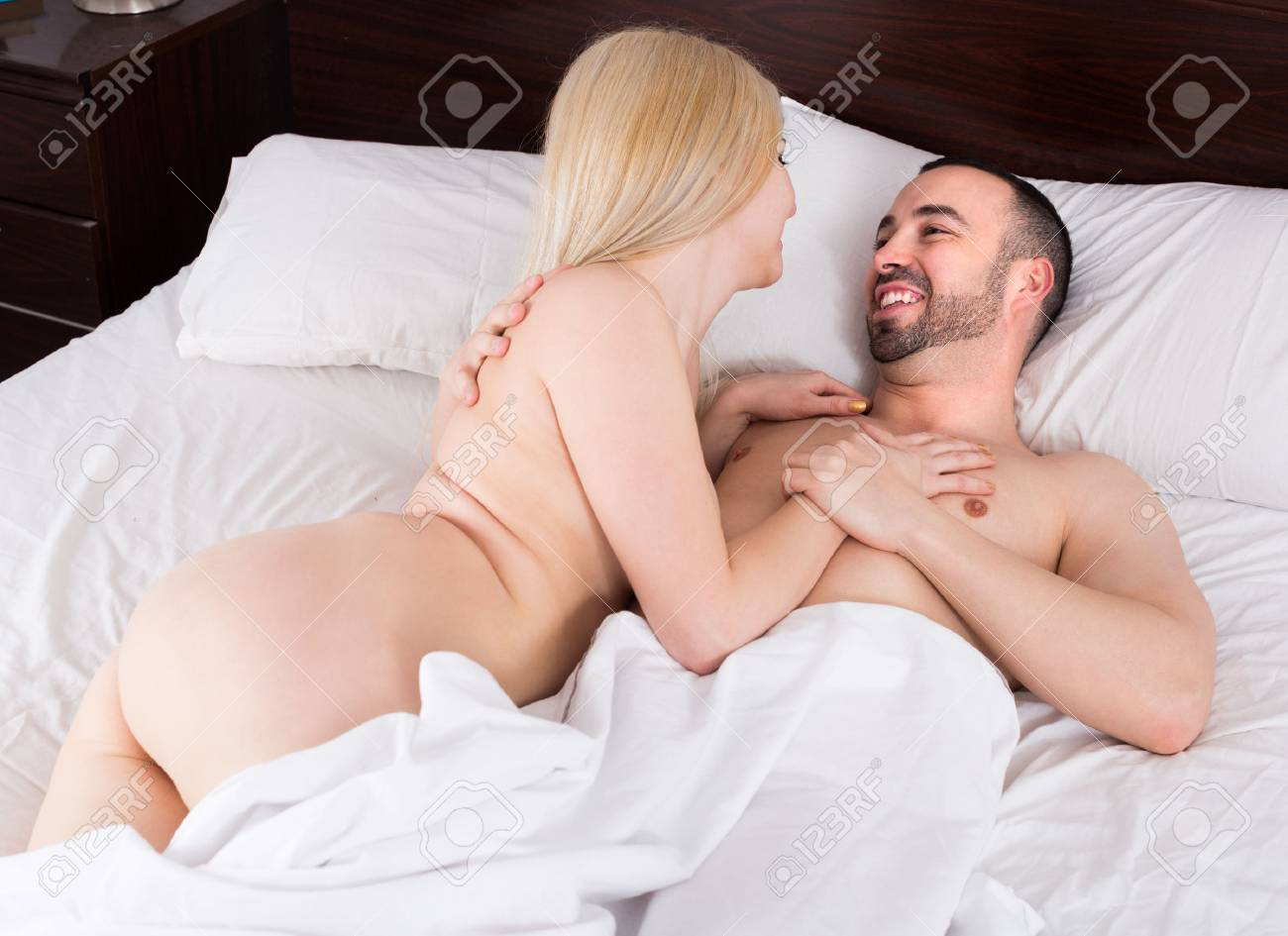 Passionate Young Loving Couple Making Love In Comfortable Family