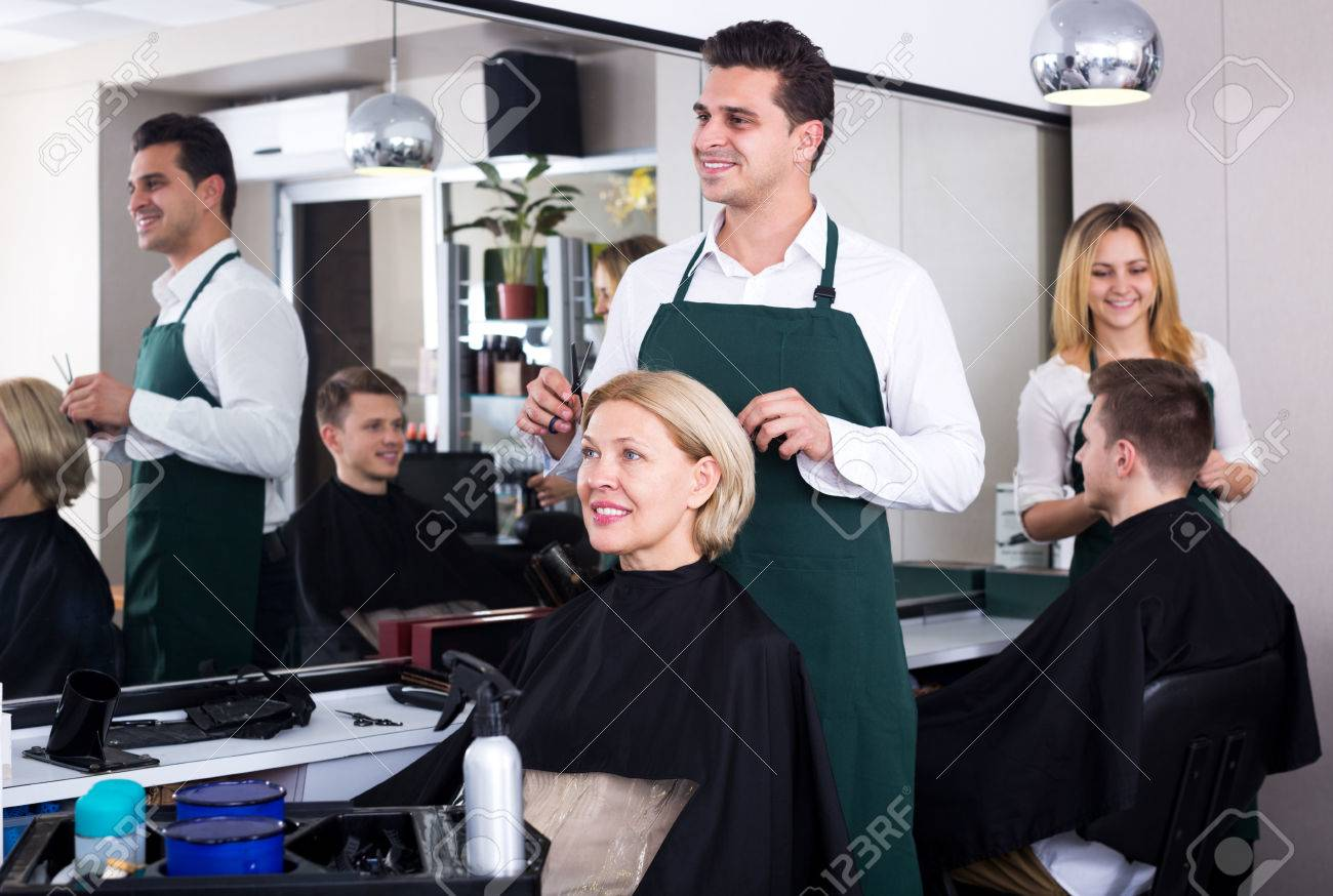 Prime Adult Male Stylist Cutting Hair Of Elderly Blonde In Salon Focus Download Free Architecture Designs Rallybritishbridgeorg
