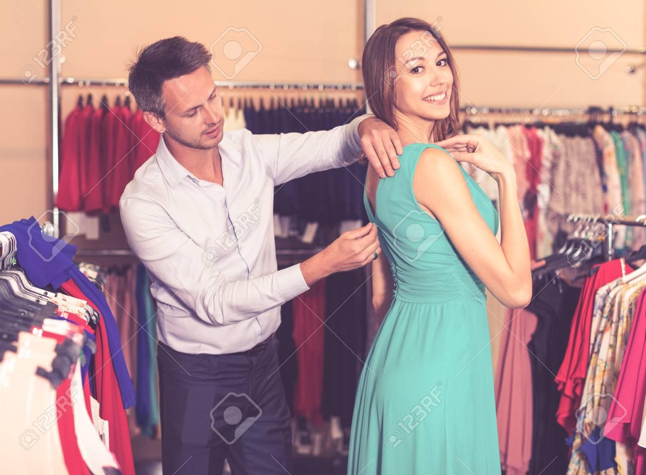 e672438e4f Portrait of family couple choosing new dress in women clothes shop Stock  Photo - 78814709
