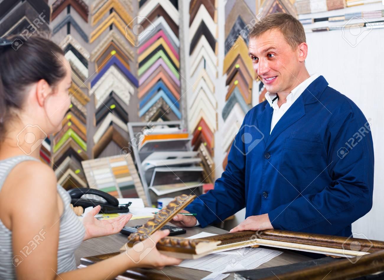 Smiling American Man Seller Talking To Customer In Picture Framing ...