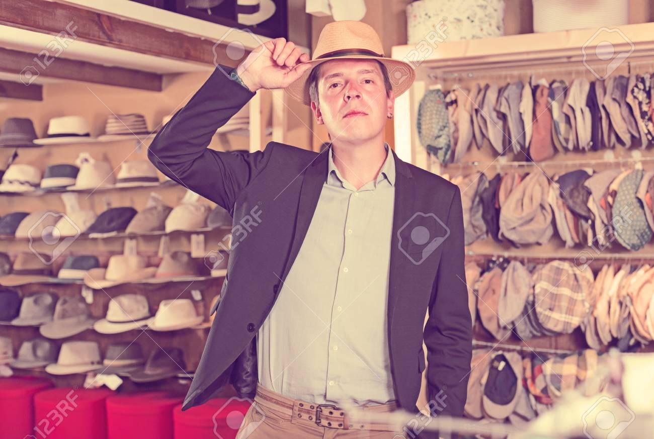 portret of happy spanish young guy try on panama at headwear store Stock  Photo - 79739850 afa7730e8fa