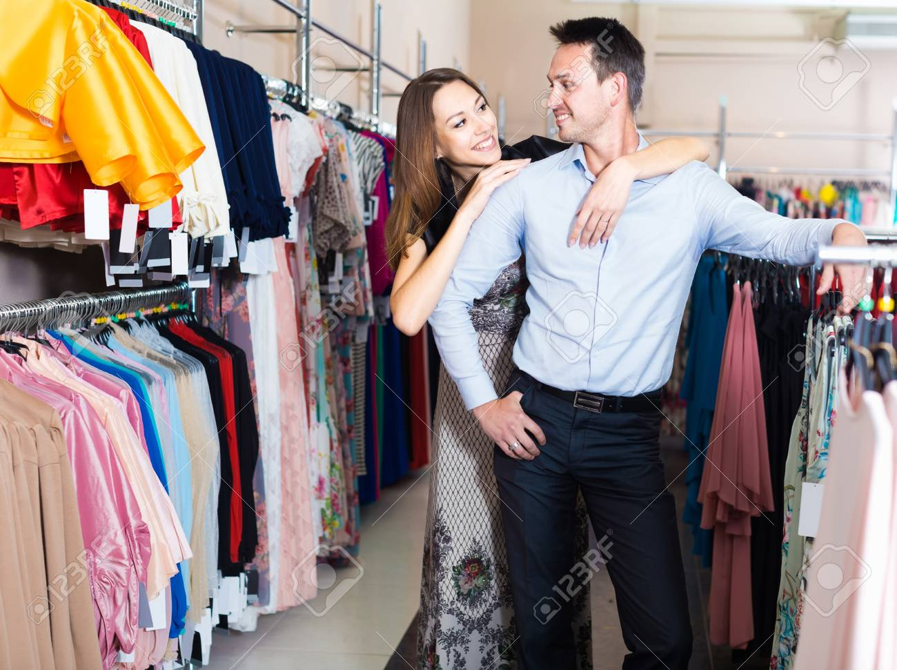 b5d718d969 Young happy english couple shopping in clothing store and enjoying together  Stock Photo - 79832016