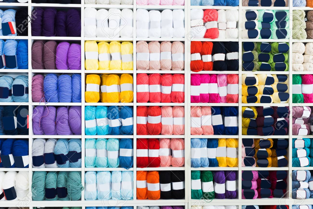 Shelves with various knitting yarn in needlework shop. - 113561808