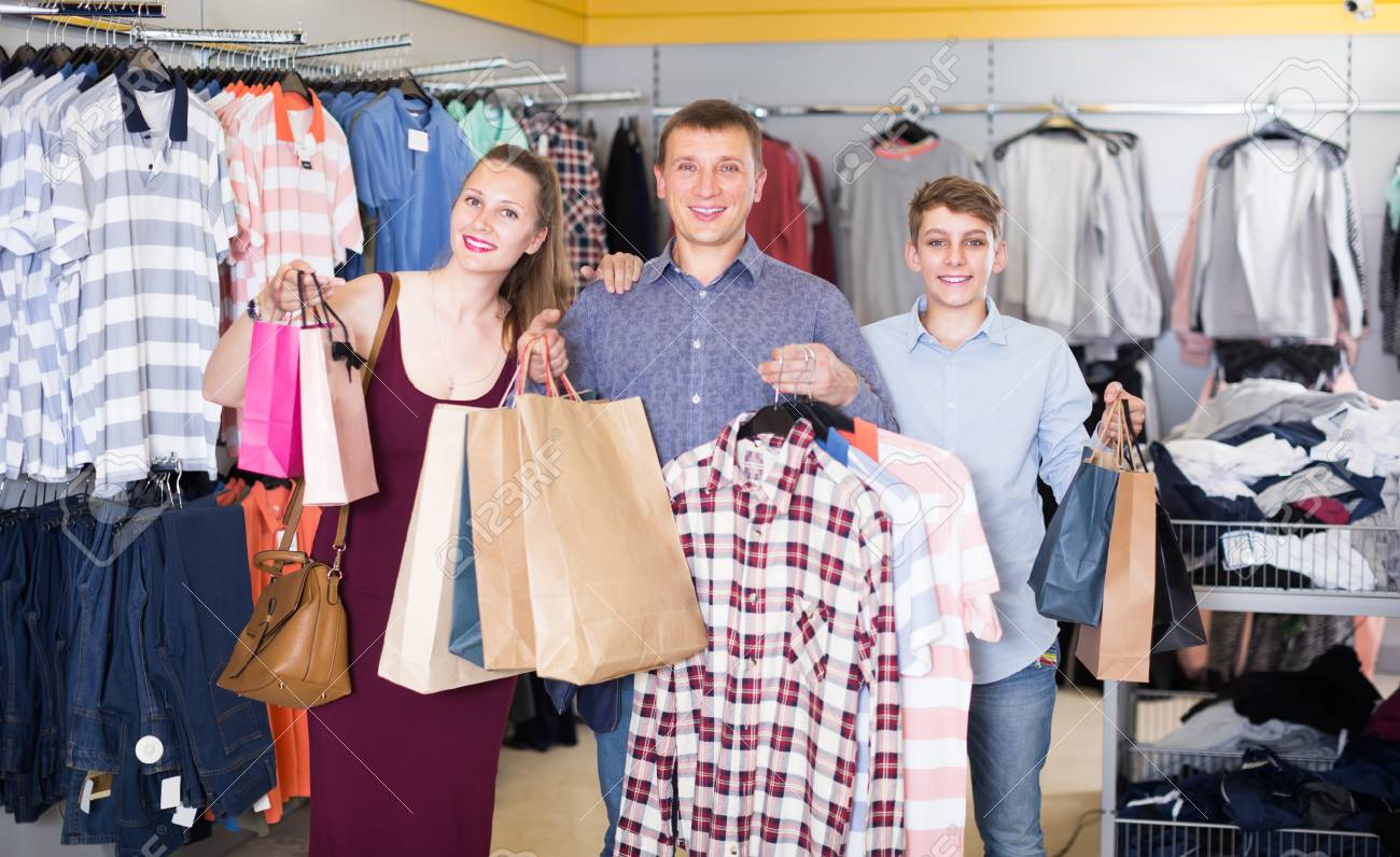 2ecec6c03 Married couple with a teenage boy enjoy shopping in a clothing store Stock  Photo - 81380450