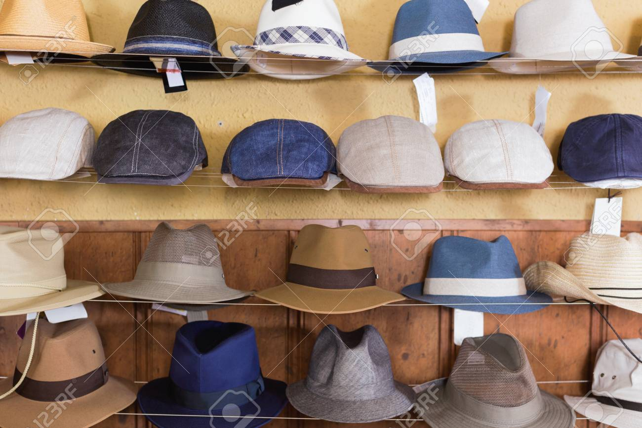Stock Photo - Trendy stylish fedora hats hanging on the wall of country shop db8402457e3