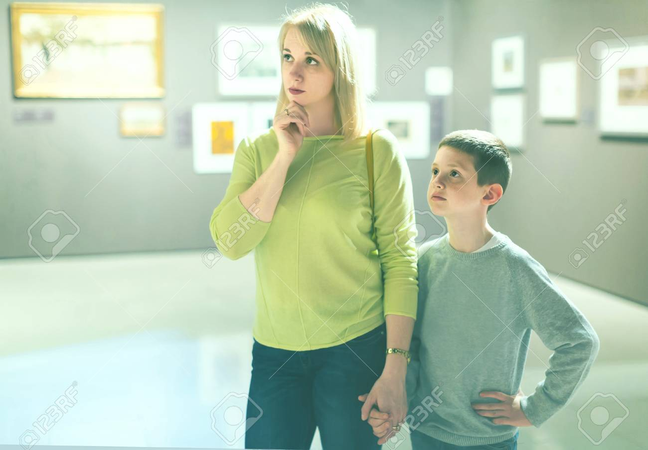 mother  and  son Russian smiling russian young mother and son looking at paintings in halls of  museum Stock Photo -