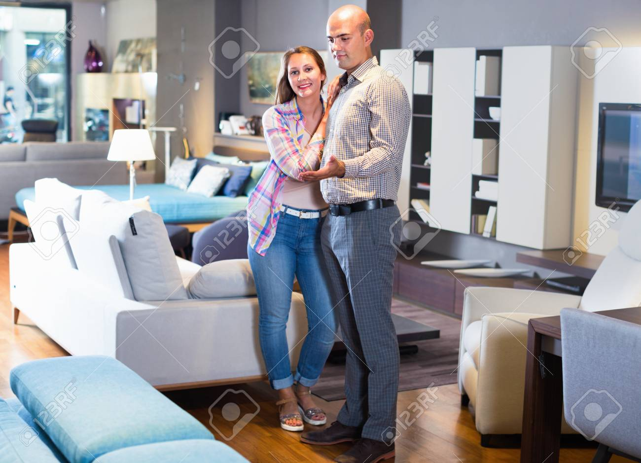 Cheerful Married Couple Looking For New Stylish Sofa In Furniture Stock Photo Picture And Royalty Free Image Image 84473066