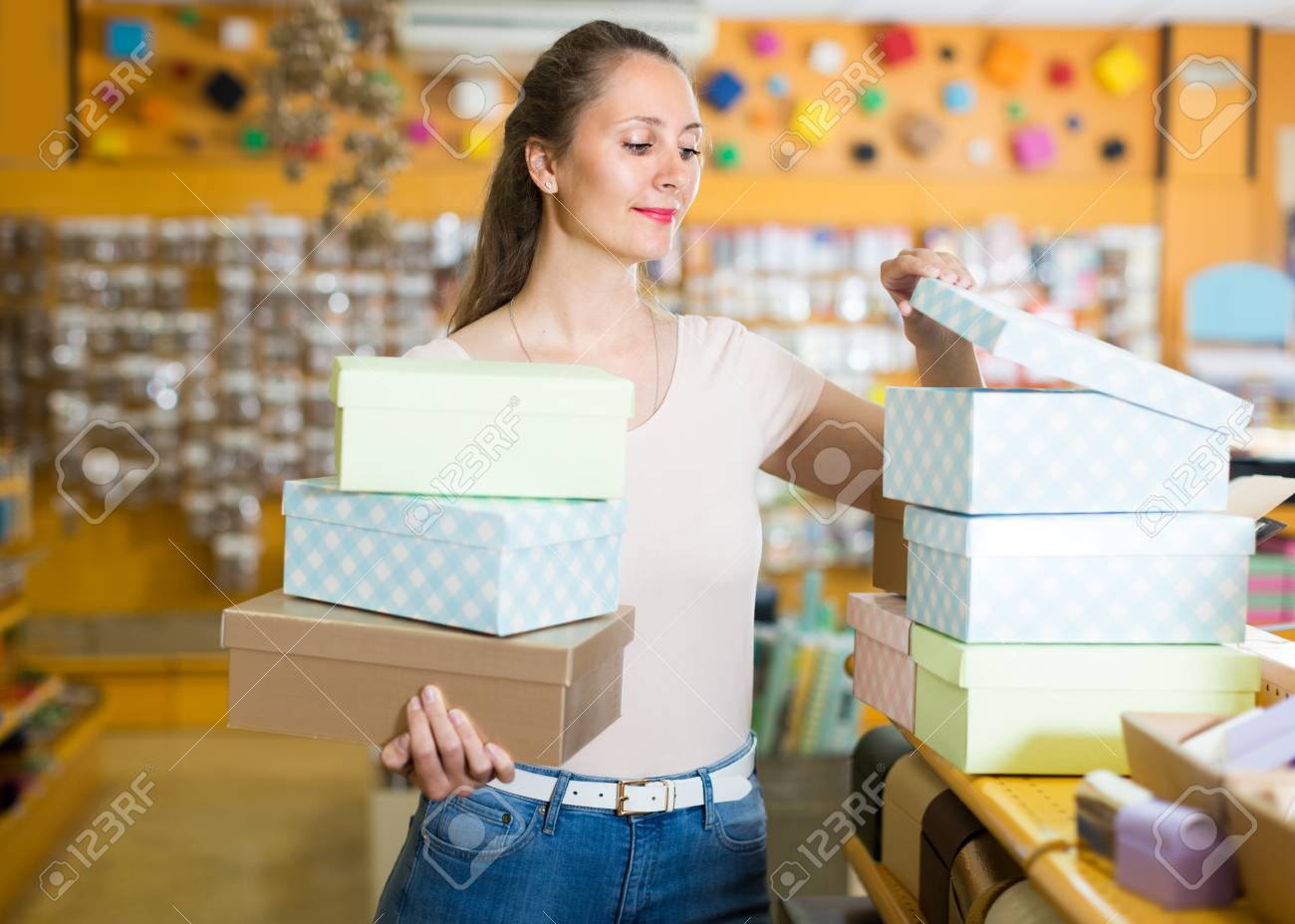 Woman 20 30 Years Old Is Choosing Light Boxes For Gifts In Store