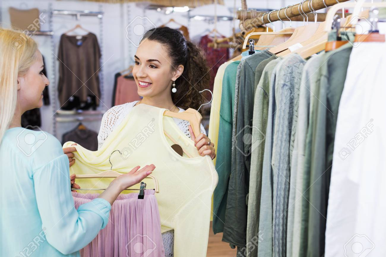 68823bfd45c47 Happy young women shopping at the clothing store Stock Photo - 91594852
