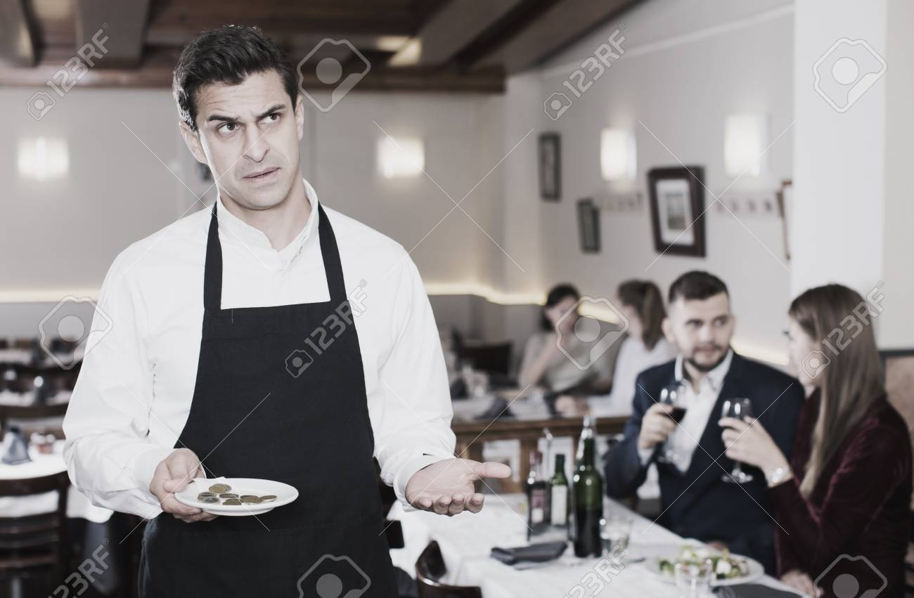 Portrait Of Waiter Dissatisfied With Small Tip From Restaurant Stock Photo Picture And Royalty Free Image Image 94967418