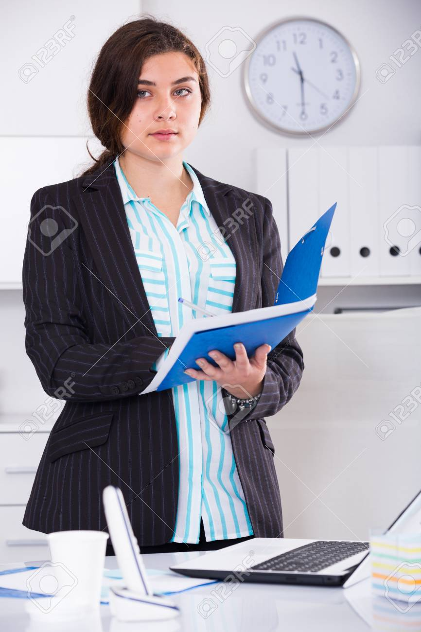 office worker woman is signing agreement papers of financial stock