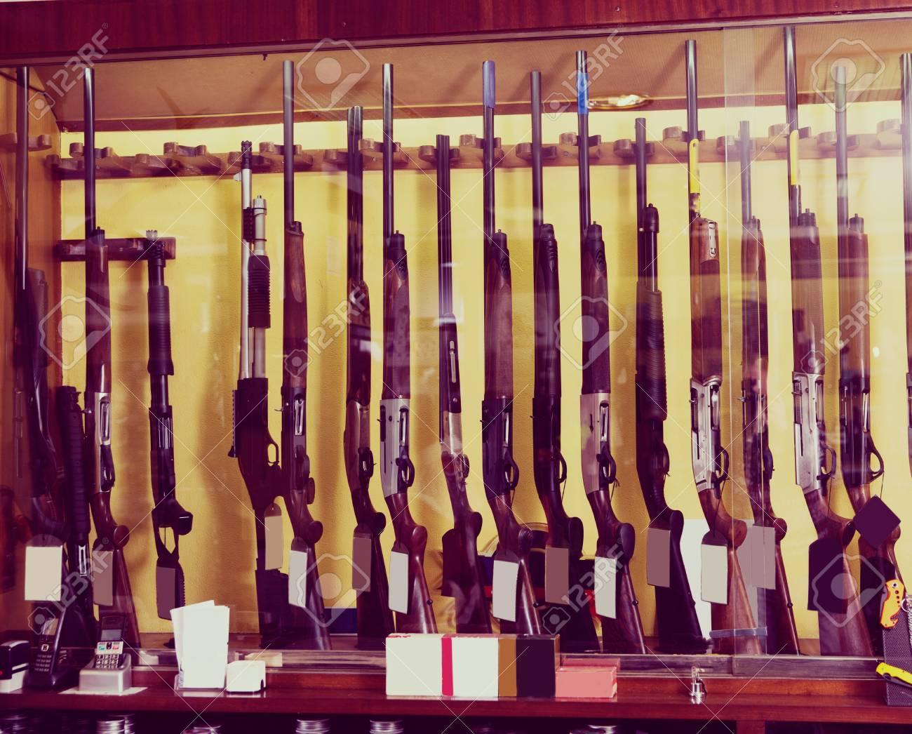 Gun Store Interior With Different Rifles On Showcase Stock Photo
