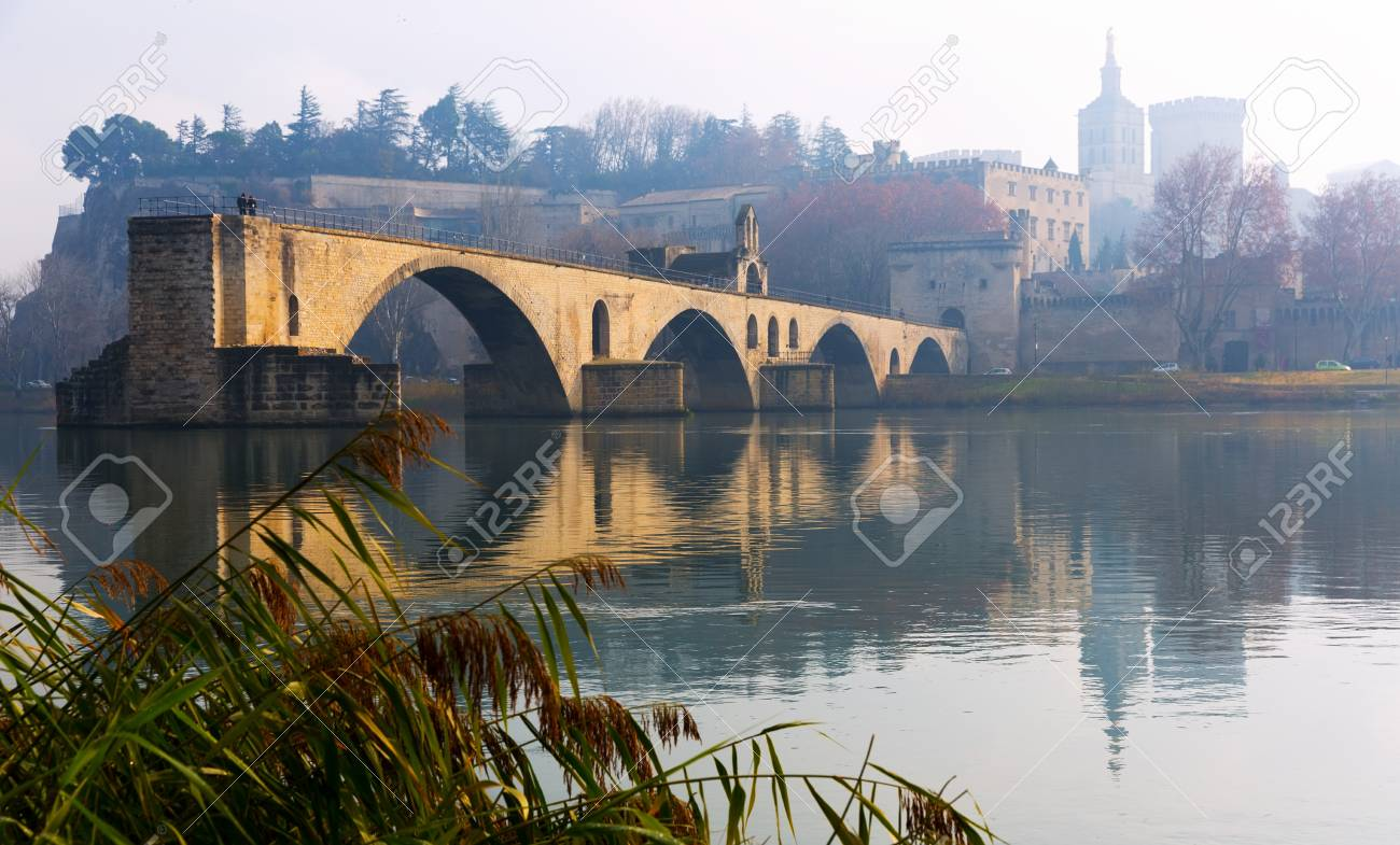 Pont Saint-Benezet and Avignon Cathedral in winter morning, France - 95909746